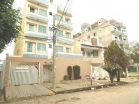 Apartamento com varanda lateral
